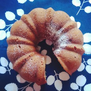 Picture of banana bundt cake on blue and white background.